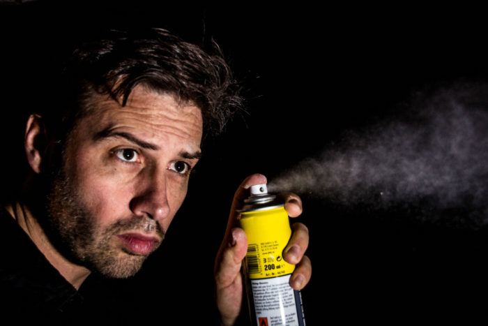 Guys Spraying a Can