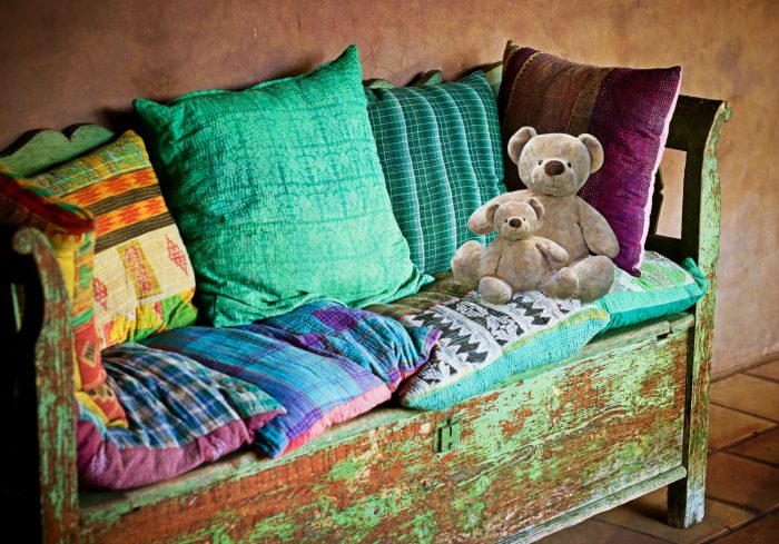 A Colourful Bed Bug Free Sofa with Pillows and Teddy Bears